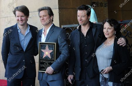 """The director and cast of """"The King's Speech"""", (from L) director Tom Hooper, actors Colin Firth, Guy Pearce and Claire Bloom pose during the unveiling of British actor Firth's star on the Hollywood Walk of Fame in Los Angeles on January 13, 2011."""