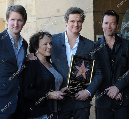 """The director and cast of """"The King's Speech"""", (from L) director Tom Hooper, actors Claire Bloom, Colin Firth and Guy Pearce pose during the unveiling of British actor Firth's star on the Hollywood Walk of Fame in Los Angeles on January 13, 2011."""