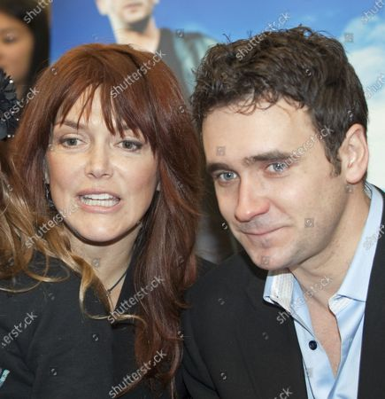 """Stock Image of Actors Lynda Boyd and Allan Hawco (R.) starring in CBC television's """"Republic of Doyle"""" greet fans and sign autographs at Metropolis at Metrotown in Burnaby near Vancouver, British Columbia, January 29, 2011."""