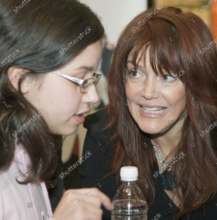 """Stock Photo of Actress Lynda Boyd (R.) starring in CBC television's """"Republic of Doyle"""" greets fans and signs autographs at Metropolis at Metrotown in Burnaby near Vancouver, British Columbia, January 29, 2011."""