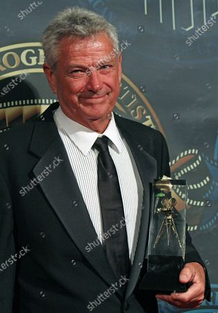 John Seale arrives on the red carpet after receiving the International Award during the 25th annual American Society of Cinematographers Awards in the Hollywood section of Los Angeles on February 13, 2011.