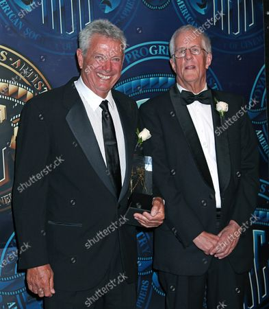 John Seale (L) and Michael Apted arrive on the red carpet after Seale received the International Award during the 25th annual American Society of Cinematographers Awards in the Hollywood section of Los Angeles on February 13, 2011.