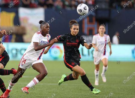 Kysha Sylla of of Olympique Lyonnais and Sophia Smith of Portland Thorns FC battle for the ball.
