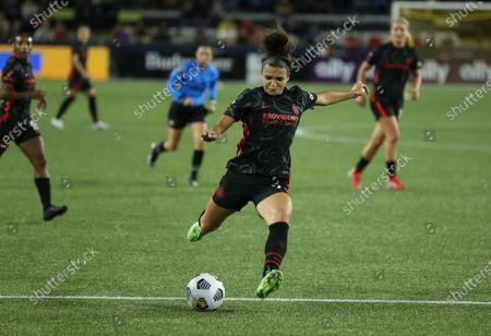 Sophia Smith of Portland Thorns FC kicks the ball against Olympique Lyonnais.