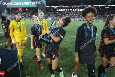 Sophia Smith of Portland Thorns FC smiles while holding the \WICC trophy.