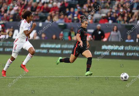 Sophia Smith of Portland Thorns FC advances the ball against Wendie Renard of Olympique Lyonnais.