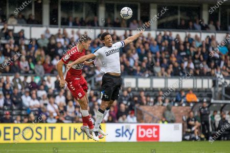 Stock Picture of Derby County defender Krystian Bielik  (5)   claims a push by Middlesbrough midfielder Sam Morsy  (5)  during the EFL Sky Bet Championship match between Derby County and Middlesbrough at the Pride Park, Derby