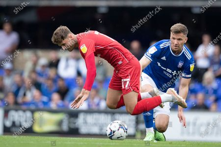 Ethan Robson, MK Dons wins the foul from Lee Evans, Ipswich Town during Ipswich Town vs MK Dons, Sky Bet EFL League 1 Football at Portman Road on 21st August 2021