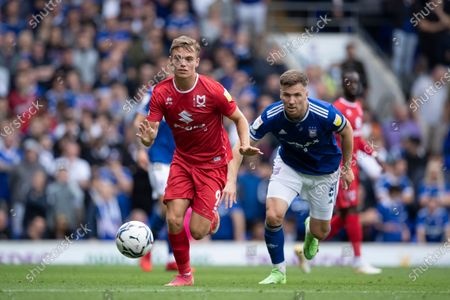 Scott Twine, MK Dons and Lee Evans, Ipswich Town chase the ball during Ipswich Town vs MK Dons, Sky Bet EFL League 1 Football at Portman Road on 21st August 2021