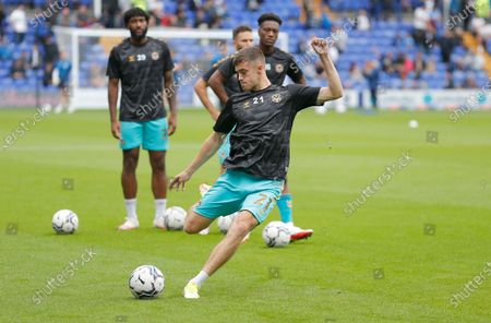Lewis Collins of Newport County warms up before the match