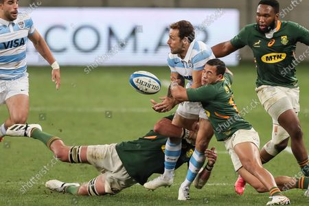 Nicolas Sanchez of Argentina is tackled by Franco Mostert and Cheslin Kolbe of South Africa during the second Rugby Championship match between Argentina and South Africa at the Nelson Mandela Bay Stadium, Gqebeha, South Africa
