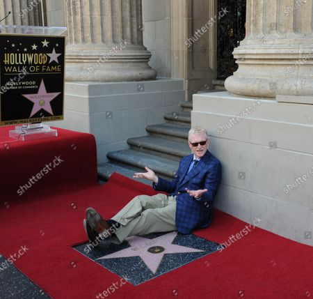CBS news correspondent and New York Times best selling author Bill Geist sits astride his star  during an unveiling ceremony honoring him with the 2,437th star on the Hollywood Walk of Fame in Los Angeles on April 15, 2011.