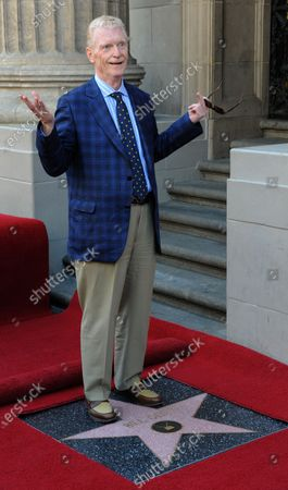 CBS news correspondent and New York Times best selling author Bill Geist stands atop his star  during an unveiling ceremony honoring him with the 2,437th star on the Hollywood Walk of Fame in Los Angeles on April 15, 2011.
