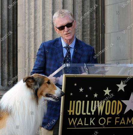 CBS news correspondent and New York Times best selling author Bill Geist makes comments as canine star Lassie looks on during an unveiling ceremony honoring him with the 2,437th star on the Hollywood Walk of Fame in Los Angeles on April 15, 2011.