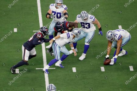 Dallas Cowboys offensive tackle La'el Collins (71) attempts to recover a fumble by quarterback Garrett Gilbert (3) while guard Zack Martin (70), center Tyler Biadasz (63), and Houston Texans defensive end Jacob Martin (54) look on during a preseason NFL football game in Arlington, Texas