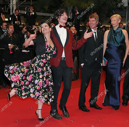 """(From L to R) Lynne Ramsay and Ezra Miller dance while Rory Stewart Kinnear and Tilda Swinton watch on the red carpet before the screening of the film """"We Need to Talk About Kevin"""" during the 64th annual Cannes International Film Festival in Cannes, France on May 12, 2011."""