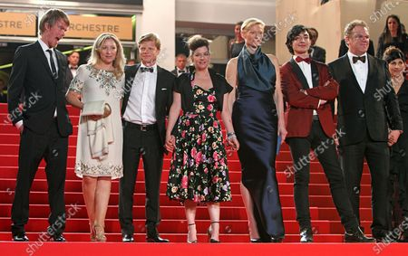 """Stock Photo of (From L to R) Rory Stewart Kinnear, guest, Luc Roeg, Lynne Ramsay, Tilda Swinton, Ezra Miller, John C. Reilly and his wife Alison Dickey arrive on the red carpet before the screening of the film """"We Need to Talk About Kevin"""" during the 64th annual Cannes International Film Festival in Cannes, France on May 12, 2011."""