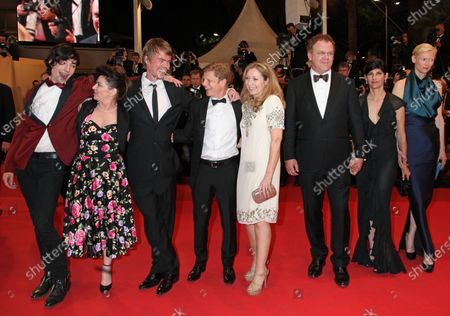 """(From L to R) Ezra Miller, Lynne Ramsay, Rory Stewart Kinnear, Luc Roeg, guest, John C. Reilly, his wife Alison Dickey and Tilda Swinton arrive on the red carpet before the screening of the film """"We Need to Talk About Kevin"""" during the 64th annual Cannes International Film Festival in Cannes, France on May 12, 2011."""