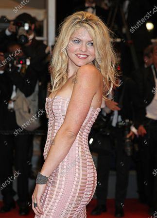 """Stock Image of Celine Durand arrives on the red carpet before the screening of the film """"Polisse"""" during the 64th annual Cannes International Film Festival in Cannes, France on May 13, 2011."""