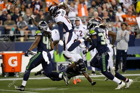 Stock Picture of Denver Broncos wide receiver Seth Williams leaps as he carries the ball against the Seattle Seahawks during the second half of an NFL preseason football game, in Seattle