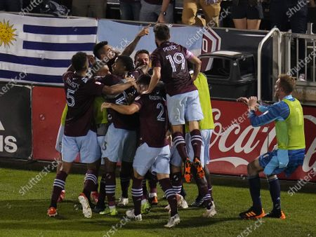 Colorado Rapids midfielder Mark-Anthony Kaye celebrates a goal against Real Salt Lake with teammate Braian Galvan (52) during the second half of an MLS soccer match, in Commerce City, Colo