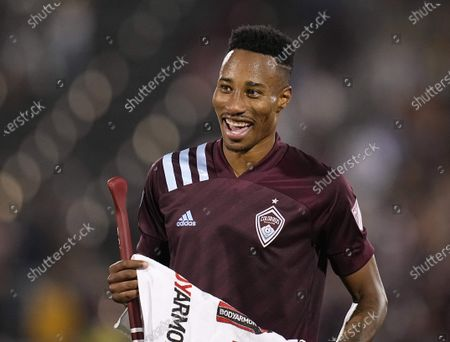Colorado Rapids midfielder Mark-Anthony Kaye smiles following the team's 2-1 win against Real Salt Lake in an MLS soccer match, in Commerce City, Colo