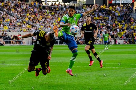 Raul Ruidiaz fights for possession of the ball with Vito Wormgoor. Seattle Sounders defeated Columbus Crew at Lower.com Field in Columbus, Ohio one Aug. 21, 2021