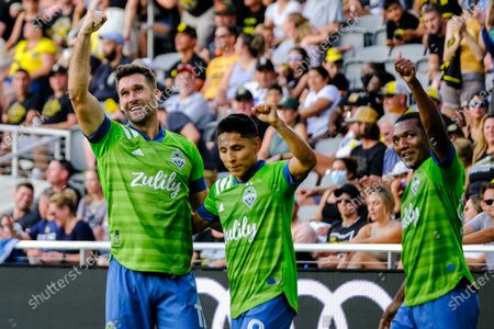 Will Bruin gestures toward the crowd with teammates Raul Ruidiaz and Abdoulaye Cissoko. Seattle Sounders defeated Columbus Crew at Lower.com Field in Columbus, Ohio one Aug. 21, 2021