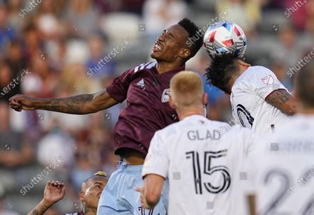 Colorado Rapids midfielder Mark-Anthony Kaye heads the ball next to Real Salt Lake defender Marcelo Silva (30) during the first half of an MLS soccer match, in Commerce City, Colo