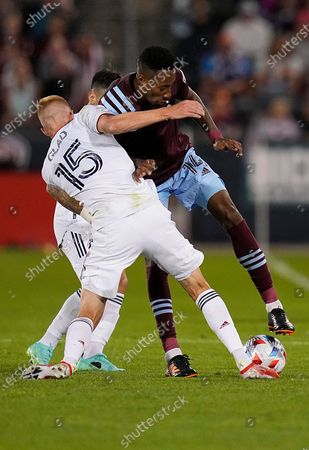 Colorado Rapids midfielder Mark-Anthony Kaye tangles with Real Salt Lake defender Justen Glad (15) for possession during the first half of an MLS soccer match, in Commerce City, Colo