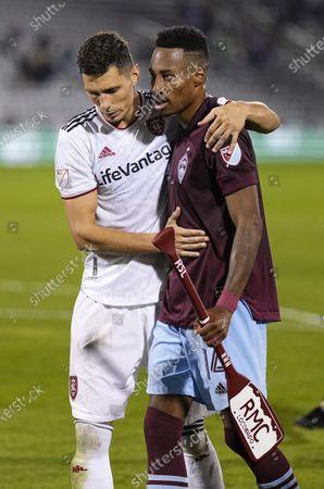 Real Salt Lake midfielder Damir Kreilach, left, congratulates Colorado Rapids midfielder Mark-Anthony Kaye (14) following an MLS soccer match, in Commerce City, Colo