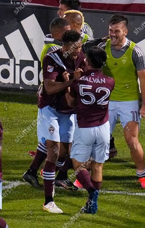 Colorado Rapids midfielder Mark-Anthony Kaye celebrates a goal against Real Salt Lake with Braian Galvan (52) during the second half of an MLS soccer match, in Commerce City, Colo