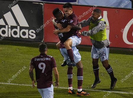 Colorado Rapids midfielder Mark-Anthony Kaye (14) celebrates a goal against Real Salt Lake with teammate Braian Galvan (52) during the second half of an MLS soccer match, in Commerce City, Colo