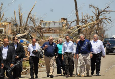 (L - R) Administrator of the Federal Emergency Management Agency, William Fugate, U.S. U.S. President Barack Obama and Missouri Governor Jay Nixon walk together during a visit to the community that was devastated a week ago by a tornado on May 29, 2011 in Joplin, Missouri.  The tornado, which was packing winds of more than 200 mph, is now considered to hold the record for the highest death toll in U.S. history.
