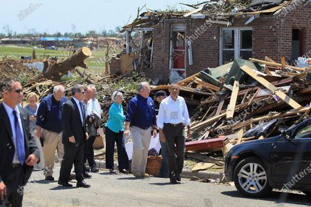President Barack Obama walks with Missouri Governor Jay Nixon as they greet people during a visit to the community that was devastated a week ago by a tornado on May 29, 2011 in Joplin, Missouri.  The tornado, which was packing winds of more than 200 mph, is now considered to hold the record for the highest death toll in U.S. history.