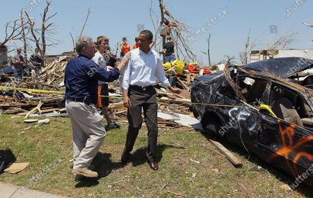 U.S. President Barack Obama and Missouri Governor Jay Nixon (L) speak during a visit to the community that was devastated a week ago by a tornado on May 29, 2011 in Joplin, Missouri.  The tornado, which was packing winds of more than 200 mph, is now considered to hold the record for the highest death toll in U.S. history.