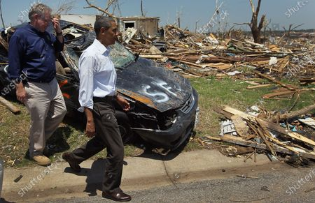 U.S. President Barack Obama and Missouri Governor Jay Nixon walk together during a visit to the community that was devastated a week ago by a tornado on May 29, 2011 in Joplin, Missouri. The tornado, which was packing winds of more than 200 mph, is now considered to hold the record for the highest death toll in U.S. history.