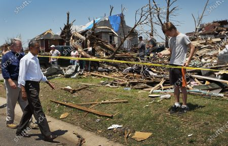 U.S. President Barack Obama and Missouri Governor Jay Nixon (L) walk together during a visit to the community that was devastated a week ago by a tornado on May 29, 2011 in Joplin, Missouri.   The tornado, which was packing winds of more than 200 mph, is now considered to hold the record for the highest death toll in U.S. history.