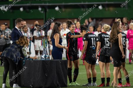 Sophia Smith (9 Portland Thorns) and Rocky Rodríguez (11 Portland Thorns) during the medal ceremony the Womens International Champions Cup Final game between Portland Thorns and Olympique Lyonnais at Providence Park in Portland, Oregon.