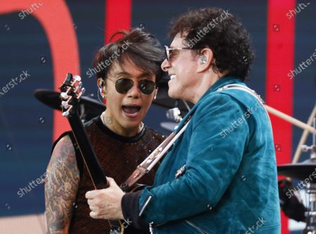 Arnel Pineda (L) and Neal Schon of Journey performs at the 'We Love NYC: The Homecoming Concert'  In Central Park in New York City on Saturday, August 21, 2021. The Event ended abruptly when thunder storms and lightning related to Hurricane Henri moved into the area.