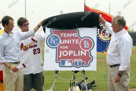 Missouri Governor Jay Nixon (R) along with St. Louis Cardinals President Bill DeWitt III and third baseman David Freese unveil a new logo in Joplin, Missouri on June 8, 2011, that will be used for the upcoming I-70 series between the Cardinals and the Kansas City Royals in St. Louis on June 17-19. The events will benefit victims of the devastating May 22 tornado that destroyed thousands of homes and businesses and killed 141 people in Joplin, Missouri.