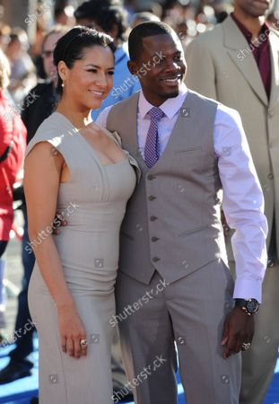 """Derek Luke and his wife Sophia Adella attend the premiere of the film  """"Captain America: The First Avenger"""" at the El Capitan Theater in the Hollywood section of Los Angeles on July 19, 2011"""