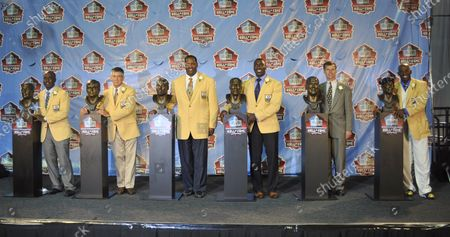 Stock Picture of Members of the Class of 2011 Marshall Faulk, from left, Chris Hanburger, Richard Dent, Shannon Sharpe, Jon Richter and Deion Sanders pose during the Pro Football Hall of Fame Enshrinement Ceremonies at Fawcett Stadium in Canton, Ohio, on August 6, 2011. Jon Richter is representing his father Les Richter who passed away in 2010.