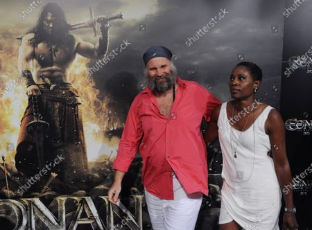 """German director Marcus Nispel (L) attends the premiere of his new motion picture horror fantasy """"Conan the Barbarian"""", with his wife, songwriter Dyan Humes at the Regal Theatre in Los Angeles on August 11, 2011."""