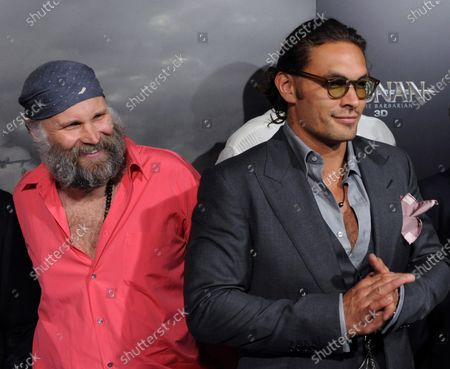 """German director Marcus Nispel (L) and Jason Momoa, a cast member in the motion picture adventure fantasy """"Conan the Barbarian"""", attend the premiere of the film at the Regal Theatre in Los Angeles on August 11, 2011."""