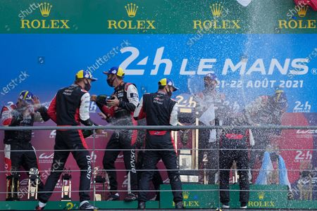 The Toyota Gazoo Racing's winner drivers Mike Conway of Britain, Kamui Kobayashi of Japan and Jose Maria Lopez of Argentina, and the second placed drivers Sebastien Buemi of Switzerland, Kazuki Nakajima of Japan and Brendon Hartley of New Zeland, celebrate on the podium of the 24-hour Le Mans endurance race, in Le Mans, France