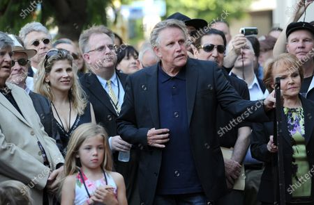 The late Buddy Holly received a posthumous star on Hollywood's Walk of Fame on his 75th birthday on Vine Street in front of The Capitol Records Building in Los Angeles on September 7, 2011. L-R; John Phil Everly, Stephanie and Gary Busey and Maria Elena Holly wait for their turn to speak at the event.