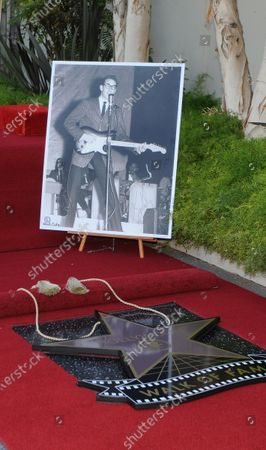 The late Buddy Holly receives a posthumous Walk of Fame Star on his 75th birthday on Vine Street in front of The Capitol Records Building in Los Angeles on September 7, 2011.