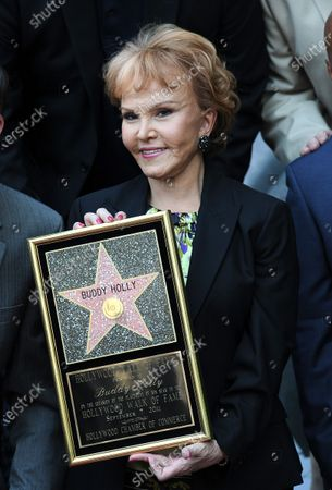 Buddy Holly's widow Maria Elena Holly holds a plaque as the late Holly received a posthumous Star on his 75th birthday on the Walk of Fame in front of The Capitol Records Building in Los Angeles on September 7, 2011.