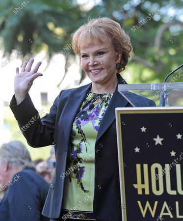 The late Buddy Holly received a posthumous star on Hollywood's Walk of Fame on his 75th birthday on Vine Street in front of The Capitol Records Building in Los Angeles on September 7, 2011. His widow, Maria Elena waves at the event.